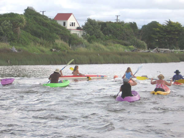Several people in brightly coloured kayaks.